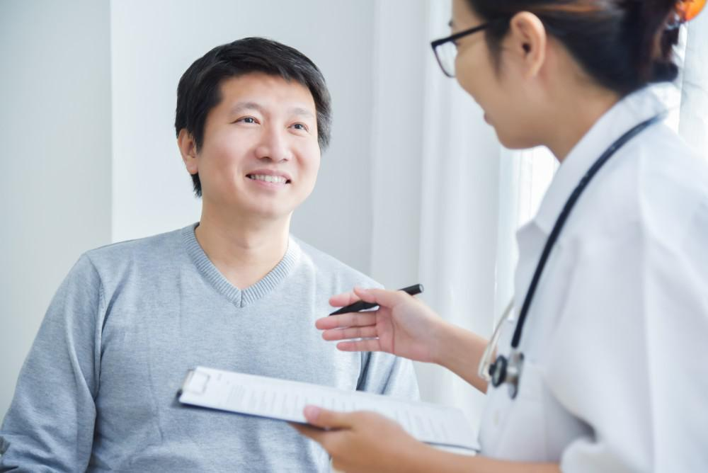 Doctor talking with a smiling patient