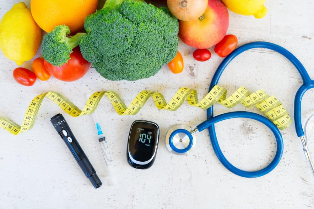 Healthy foods on a table next to a stethoscope