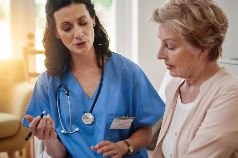 Doctor discussing hormone replacement treatment with a patient