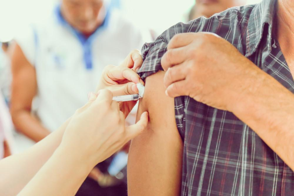 Close-up of a patient getting a shot in their arm